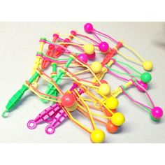 Neon Plastic Clackers . . Can't believe my Mom let me play with these as much as she did. I'm sure it annoyed the crap out of her.