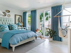 It would be hard to get up in the morning in this bedroom! | Back on the first level, Brian Patrick Flynn went with a curated look in the terrace bedroom that opens to this breathtaking view. Breezy blues in a multitude of patterns inspired the design for this space >> http://www.hgtv.com/design/hgtv-dream-home/2016/terrace-bedroom-pictures-from-hgtv-dream-home-2016-pictures?soc=dh16pp