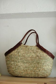 Trapezoid basket bag with leather handles