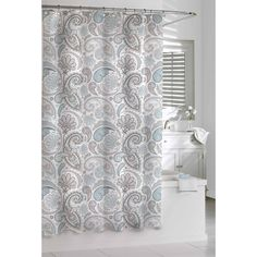 This beautiful bathroom shower curtain features a light color with a paisley print in thin, clean lines. The cotton curtain is machine washable for easy care.
