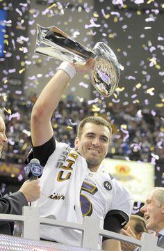 Joe Flacco ( Baltimore Sun photo by Lloyd Fox / February 3, 2013 ) Joe Flacco, the Super Bowl MVP. holds up the Lombardi Trophy.
