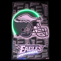 "EAGLES HELMET NEON/LED PICTURE-NN3EAGLE  23"" wide, 35"" high, 1"" deep  Show your love for the Birds with our Philadelphia Eagles Helmet Neon/LED Poster. The hand blown neon tubing is complemented with bright, multi-colored LED lights. The Philadelphia Eagles Helmet Neon/LED Poster will bring the warm neon glow and illuminating brightness of LED to your space."