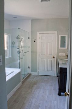 Wall paint for shower with border.  This works, as chroma is NOT stronger or brighter than tile.  http://lifewith50toes.blogspot.com/2013/10/a-medicine-cabinet.html