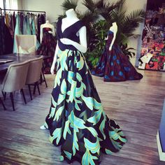 Palm leaf print overlay gown on display in the showroom today.