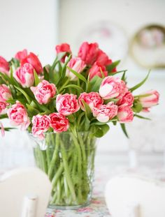 I like very casual floral arrangements - flowers just stuck in a vase with minimal arrangement, if any!