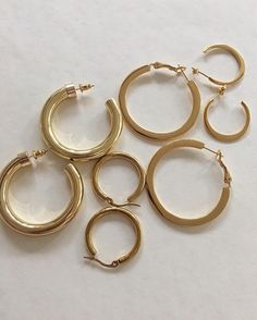 Chunky hollow hoops, gold crescent shape hoop earrings, flat-out gold hoops and more. These designs are available in silver too. www.thehexad.com