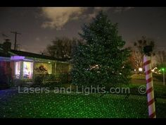 The Spright Laser Starfield projector is the ultimate Christmas lighting tool. A single projector at the top of the candy cane type pool is on each corner of the lawn at this home. Laser Christmas Lights, Hanging Christmas Lights, Christmas Tree, Outdoor Projector, Light Project, Outdoor Landscaping, Outdoor Settings, Outdoor Lighting, Photo Galleries