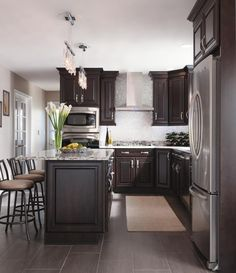 Dark brown cabinetry with a sparkly backsplash #cabinetsolutionsusa