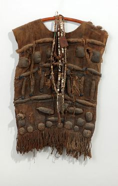 West Africa   Hunter's shirt with amulets   Woven raffia, leather and horns