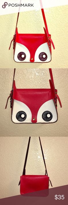 """Super Kawaii Fox Crossbody Purse  In perfect condition. Never used. Red and white Faux leather Crossbody purse. The front of the purse is a fox face, with actual ears that protrude from the purse. Measurements: width: 9"""" length: 7"""" strap drop: 20"""". Absolutely no flaws. Bags Crossbody Bags"""