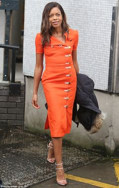 Bright spark: Naomie Harris looked sensational in fiery orange after appearing on morning ...
