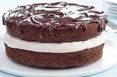 Chocolate cake layers made with cake mix, pudding mix, sour cream, coffee and chocolate chunks, then spread with a coffee-flavored  filling, stacked and drizzled with a chocolate glaze.