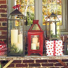 Put Out Christmas Lanterns - 101 Fresh Christmas Decorating Ideas - Southernliving. Arrange a grouping of festive lanterns at your entryway for quick-and-easy holiday style. Consider using flameless candles as a worry-free alternative to regular pillars. Decoration Christmas, Christmas Lanterns, Christmas Porch, Noel Christmas, Winter Christmas, All Things Christmas, Outdoor Christmas, Holiday Decorations, Christmas Ideas