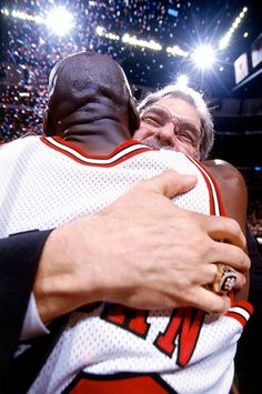 The leagues greatest coach and player of all time embrace a championship victory