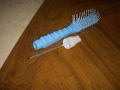 80's hairbrush and spray - all in 1!