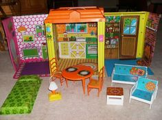 Barbie house. You stored all the furniture in the center section and folded the house up for storage.