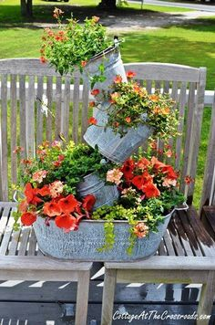 Outdoor Decorating/Gardening :     tutorial on how to make topsy turvy galvanized buckets planter    -Read More –