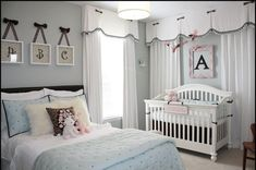 Shared bedroom. Looks like a preteen or wiggly young lady shared this room with the newborn baby, but I love the soft tones and lovely decor!