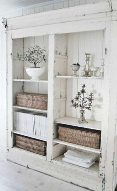 I wouldn't distress the piece as much, but something like this would be fantastic in my dining/kitchen area for open storage. LOVE!