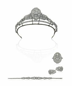An Art Deco diamond tiara/necklace. The central plaque of stylised foliate openwork design set throughout with old brilliant and single-cut diamonds, between similarly-set foliate scrolls, to a tapering fancy-link necklace set with old-cut diamonds throughout, converts to a brooch, earclips and a bracelet, circa 1930