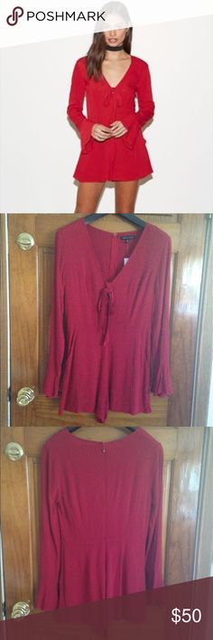 Big Sale!!! NWT Kendall & Kylie romper NWT Kendall & Kylie deep-v long sleeve romper size Small originally $49.95. Includes a removable tie fabric near the top of the v-neck. Note I draw through the barcode so it can't be returned. Kendall & Kylie Pants Jumpsuits & Rompers