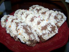 TheKitchenCookie   Rice crispy roll up.  Mini marshmallows. PB. Choc chips