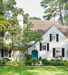 How To Update A Tudor Style Home Exterior Turquoise Front Door For A White Brick Facade House House Of Turquoise, Turquoise Door, Teal Door, Turquoise Kitchen, Exterior Paint, Exterior Design, Exterior Shutters, Exterior Colors, Painted Front Doors