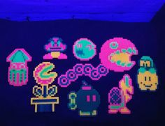 Mario sprites in blacklight reactive perlers by the_living_dead_111