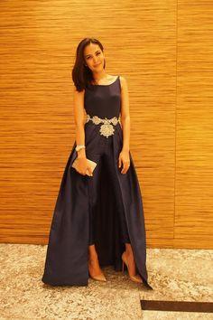 Vania Romoff 2-piece outfit; Vera Wang belt; Christian Louboutin pumps; Swarovski bag; Cartier watch.