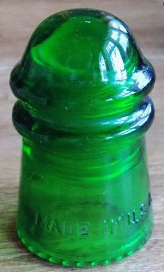 Hemingray-9 Made In U.S.A. 7-Up green antique glass insulator.