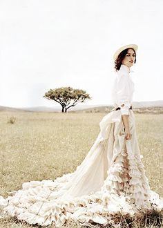 Love the delicate ruffles and the swoop of the  train of the skirt is to die for