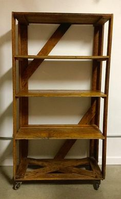 This authentic antique shelving is a great combination of warm, rustic wood and metal hardware. It will make excellent storage or display in a…