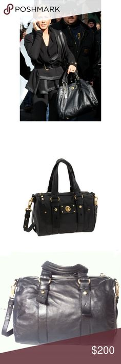 MBMJ Totally Turnlock Shifty Handbag Beautiful supple black large handbag. Leather, gold accents (one tiny design only grommet on front of bag is missing, hence the low price). Removable cross body strap, inside has pockets & signature Marc Jacobs logo. Authentic, no trades. Marc by Marc Jacobs Bags