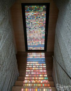 Idea: tiny pieces of stained glass tile door.