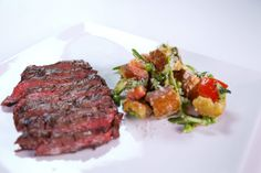 the chew--Michael Symon's Grilled Skirt Steak with Asparagus and Pea Panzanella Salad