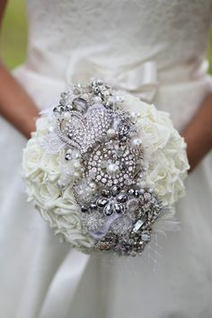I love this....tons of blingy rhinestone jewels running across an all white bouquet.