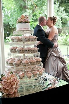 wedding cupcakes with beautiful decor, Latte wedding dress, david austin roses, and cupcakes topped with latte icing.