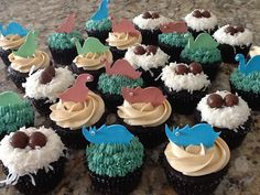 Chocolate cupcakes with peanut butter, coconut, and peppermint Swiss meringue buttercreams, topped with hand sculpted sugar dinosaurs.