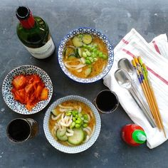 Miso soup with big rice gluten-free noodles, zucchini, sesame oil and edamame, kimchi and Sriracha.