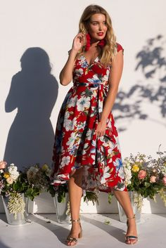 Fanciful Ruby Red Wrap Dress featuring a fitted cross over bust and flirty skirt in a retro large floral print, cute wrap around dress, red dress