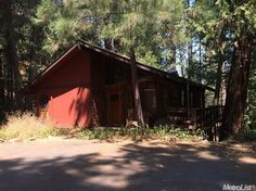 931 Chili Aly, Placerville, CA 95667 — Excellent value, priced right! 3 bedroom, 2 bath home in a secluded setting, surrounded by trees. The floor plan is open and spacious! Huge wrap around deck upstairs plus the basement bonus room has a covered, walk-out patio. Lots of storage in garage. Convenient to schools, parks, shopping & freeway access. Selling in its present condition.