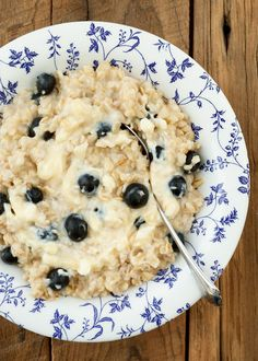 "Creamy oats, fresh blueberries, and a swirl of lightly sweetened ""cheesecake"" adds up to Blueberry Cheesecake Oatmeal! - get the recipe at barefeetinthekitchen.com"