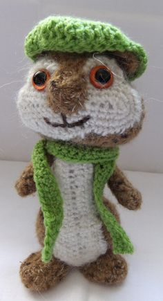"""""""Amigurumi Cap and Scarf"""". This free crochet pattern makes a cap which is approximately 6cm (2.5"""") diameter and  a scarf which is approximately 36cm (14"""") long. These items would be perfect accessories for amigurumi animals and toys. Amigurumi Cap and Scarf © Siona Karen 2011"""