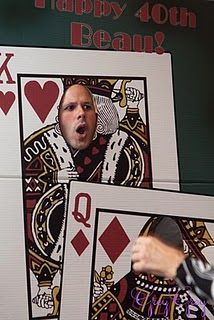 Put Dre to work! (He is our painter.) He would love to make you a Playing Card Themed photo op like this.