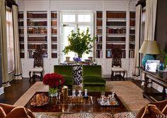 Aerin Lauder's Southampton living room.  Animal print with lush green velvet slipper chairs