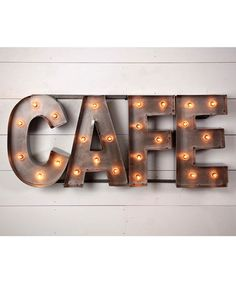 Lure customers in or use as a decorative sign at home, either way this café sign has loads of vintage charm. Little bulbs shine brilliantly against the bare steel that make up the letters. Includes ba