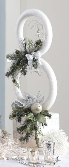 """Snowman Sculpture - Uses a 12"""" & 14"""" extruded (smooth)foam wreaths and a 8"""" cube plus various picks, etc"""