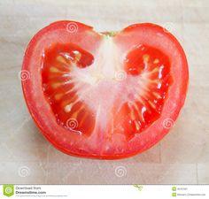 A half tomato on a desk