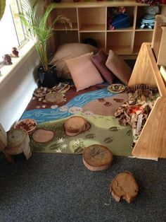 Good idea for quiet play area. Something similar could be done to create a 'book nook'.