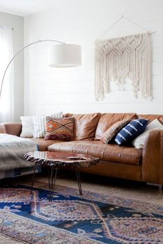 Natural, earthy, bohemian living room // caramel leather sofa